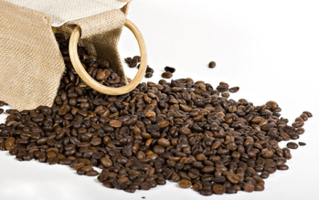 Coffee beans overflowing from a Burlap sack